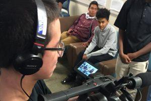 Student videographer films interviews